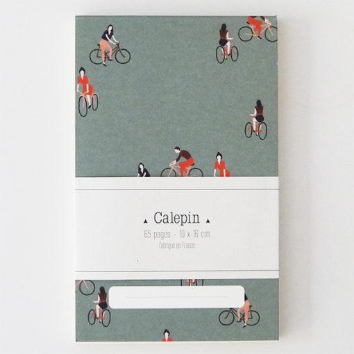 """calepin """" A bicyclette """" fabriqué en france avec des images de bonhommes en vélo"""