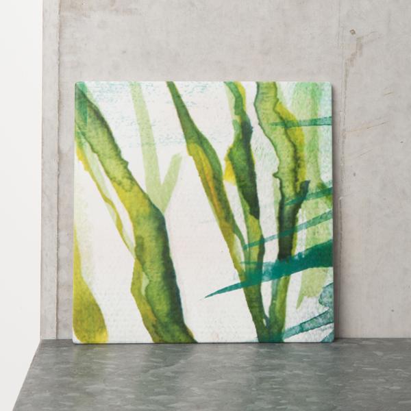 dessous de plat vert à motif végétal